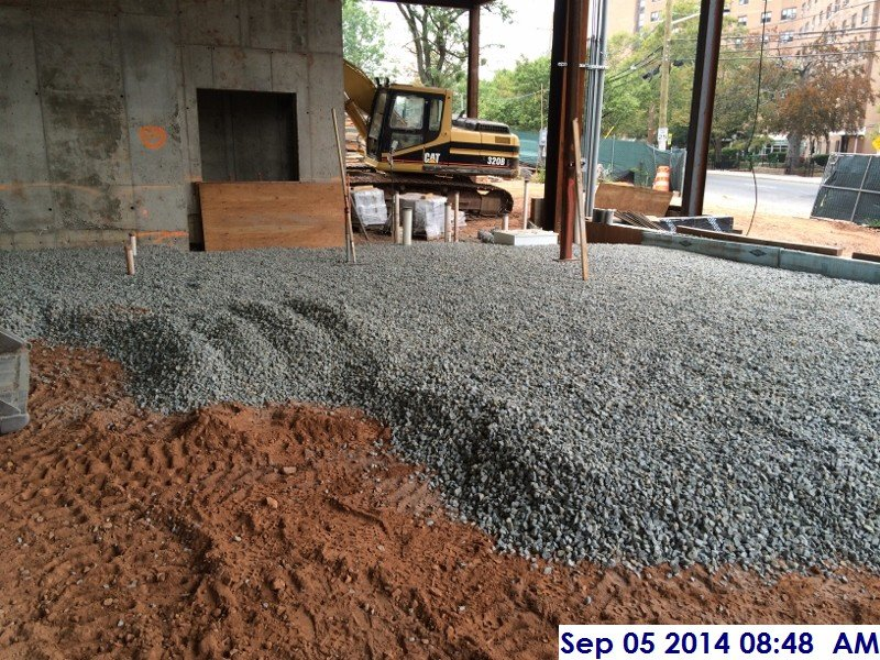 Laying Out A Room laying out gravel for the slab on grade at the servery room 105